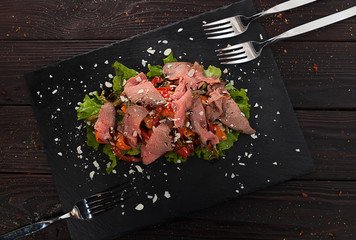 meat and fresh vegetables, meat salad, restaurant dish, sliced ham and vegetables on a plate