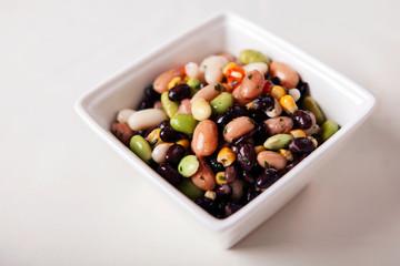 Vegan bean salad, served in a white bowl.