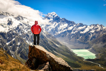 Tourism vacation and travel. Happy free tourist man standing outstretched up looking at river and mountains landscape from Mueller Hut, MT. Cook - New Zealand Fototapete
