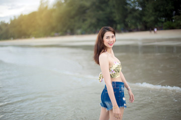 Portrait of young woman on the tropical beach