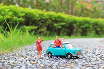 a fun of figure with small car