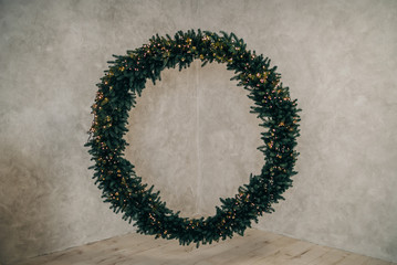 A large Christmas wreath on the wall.