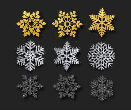 Set of beautiful golden, silver, black shiny snowflakes isolated on black background.
