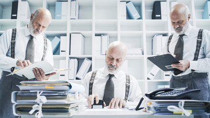 Businessman working on different tasks at the same time