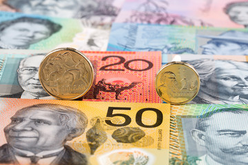 Australian Dolllar coins on the background of banknotes