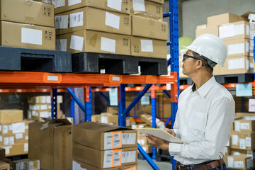 warehouse worker checking product in to stock prepare shipping to customer