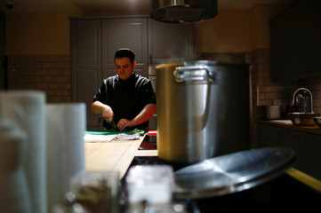 A chef of a restaurant cooks soup as part of a charity program to help homeless people in St. Petersburg