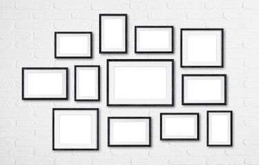Black wooden frames collage mock up, twelve frameworks collection on white bricks wall, 3d illustration