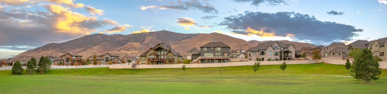 Homes overlooking mountain and a landscaped lawn