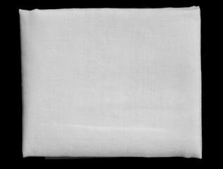 white fabric fold on black background
