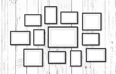 Photo frames collage , twelve black  frameworks collection on white  wooden wall