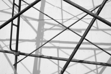 Scaffolding on renovating house under construction - in black and white
