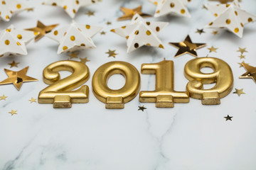 Happy new year 2019 with gold stars on a marble background