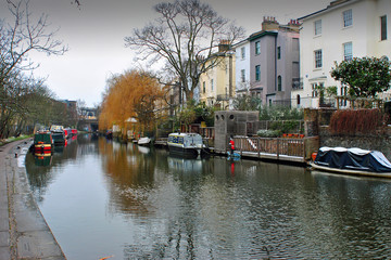 Old fashioned narrow boats along the Grand Union Canal in Camden London