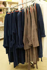 A large number of Terry bathrobes on the hanger