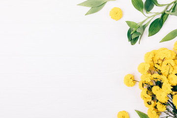 Flat lay decorative side frame of yellow bouquet