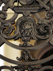 Fragment of decoration of a forged gate in Winter Palace, the Hermitage Museum at Saint Petersburg, Russia. Lion head