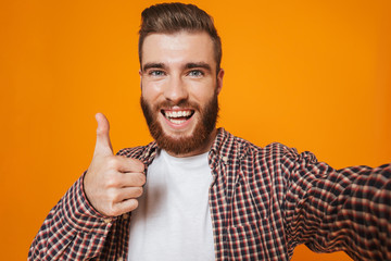Portrait of a cheerful young man wearing casual clothes