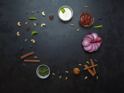 Spice set for Arabian Kabsa, Indian Biryani on black table. Top view.