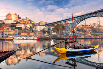 Porto, Portugal. Cityscape image of Porto, Portugal with reflection of the city in the Douro River during sunrise. Wall mural