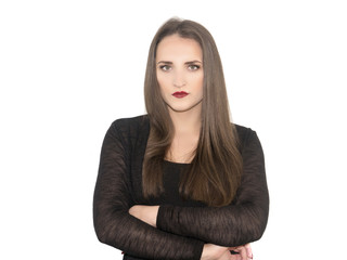 A young girl with her dark hair and a thoughtful look closed  arms. A woman in a black jacket feels despair. Isolated on a white background.