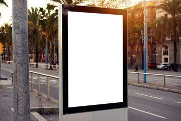 Mockup of a blank empty white advertising urban billboard, placeholder template city street, space for design layout, sunset light.
