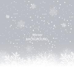 White snowflakes on gray background. winter background