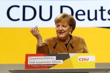German Chancellor Angela Merkel speaks at the Christian Democratic Union (CDU) party congress venue in Hamburg
