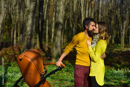Loving Husband Kiss Wife In Park Family Couple With Baby Pram Kiss