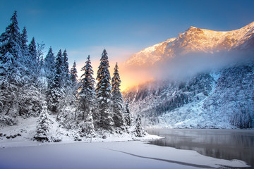 Winter mountain landscape at sunrise