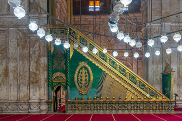 Decorated alabaster (marble) wall with green wooden platform (Minbar) at the great Mosque of Muhammad Ali Pasha (Alabaster Mosque), situated in the Citadel of Cairo in Egypt