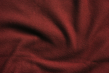 Texture of red fleece, soft insulating fabric