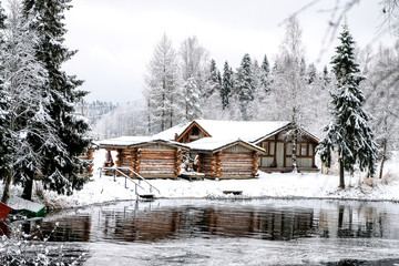 Old huts in winter forest, Karelia, Russia