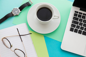 Cup of coffee on office desk concept