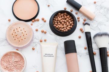 Set of skin tone cosmetics on marble background