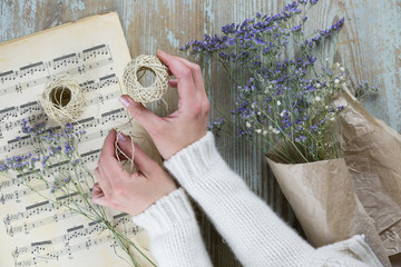 Florist hand wrapping dry lavender in paper