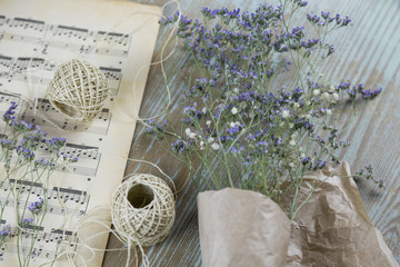 Dry lavender wrapped in paper lying on table