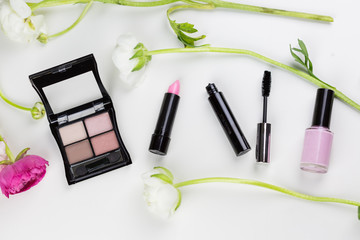 Pink themed spring cosmetics flat lay