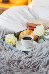 Closeup Of Open Book And Breakfast On Bed