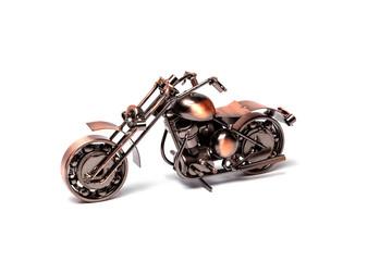 Handmade model of custom motorcycle bike. Copper scale model of chopper. Side view. Isolated on white.