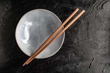 Empty bowl with chopsticks to eat.