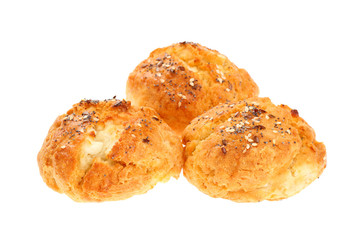 """Traditional Bulgarian breakfast called """"Dobrudzhanka"""" (from Dobrudzha region in Bulgaria). Three small bread like soda cakes with white flour, eggs and cheese, sprinkled with seeds, isolated on white"""
