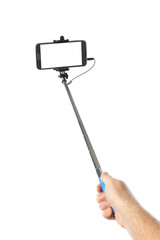 Hand and smartphone with selfie stick