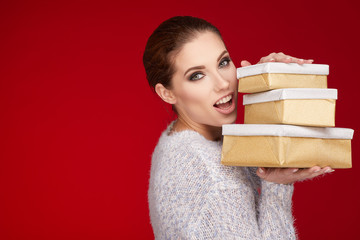 woman with christmas gift box. red background