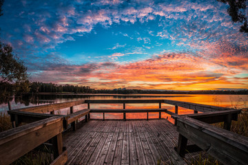 Picture of colorful sunset on the lake with wooden pier