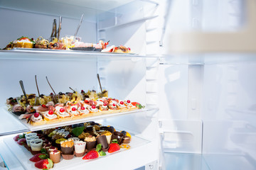 Open fridge full with food