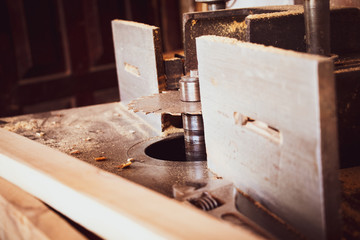 circular saw with carpenter store blur background closeup