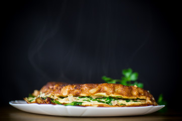 fried omelet with cauliflower and greens in a plate