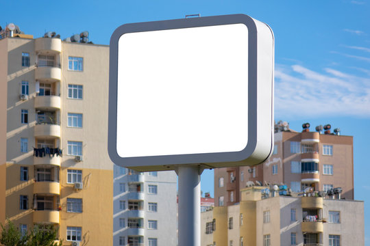 Square billboard in the city, blank template. Smaller than bulletin board, larger than poster. High impact outdoor advertising.