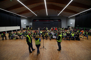 Protesters wearing a yellow vests, the symbol of a French drivers' protest against higher diesel fuel prices, attend a meeting to elect a representative to liaise with other blocade points